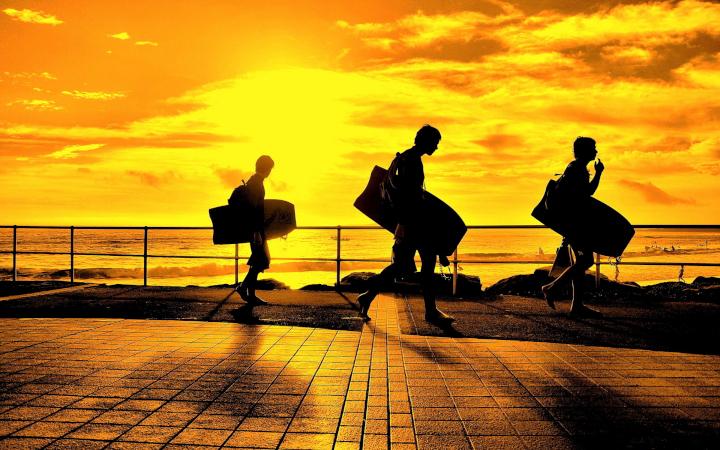 6999458-surfers-sunset